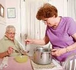 Elderly woman having daughter cooking