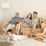 A young family watching television with grandparents. Image shot 2007. Exact date unknown.
