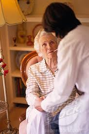 old woman taking tempurature